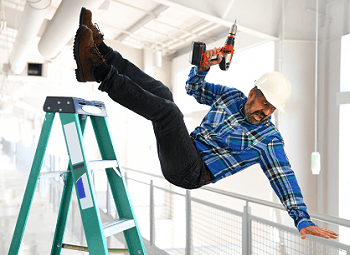 man wearing a plaid shirt and hard hat falling off a ladder while holding a drill